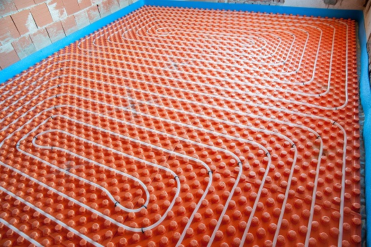 "Hydronic heating is installed along the base boards, radiators or flooring of your home and runs hot liquid through tubing to heat your home. Hydronic heating ""radiates"" heat throughout your home and is incredibly energy efficient due to the method in which the liquid is heated."